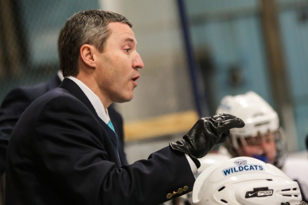 Presque Isle hockey coach Carl Flynn gives his team some last-minute instructions during a game earlier this year with Orono in Presque Isle.