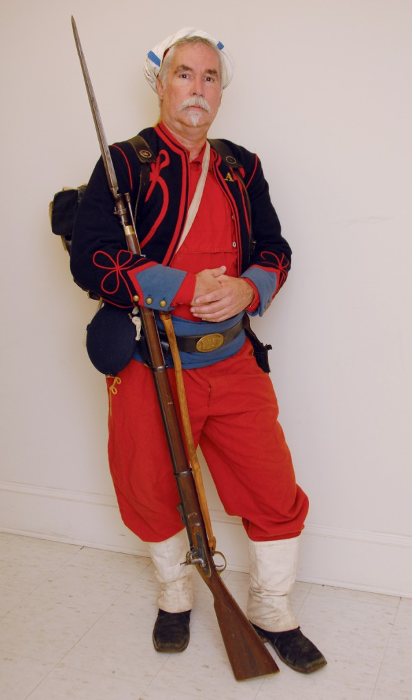 Rob &quotMaynard&quot Kufrovich is a Civil War re-enactor who portrays a Zouave belonging to the 114th Pennsylvania Infantry Regiment. He wears the colorful Zouave uniform, which was based on the North African-styled uniforms worn by French army Zouave units during the Crimean War.