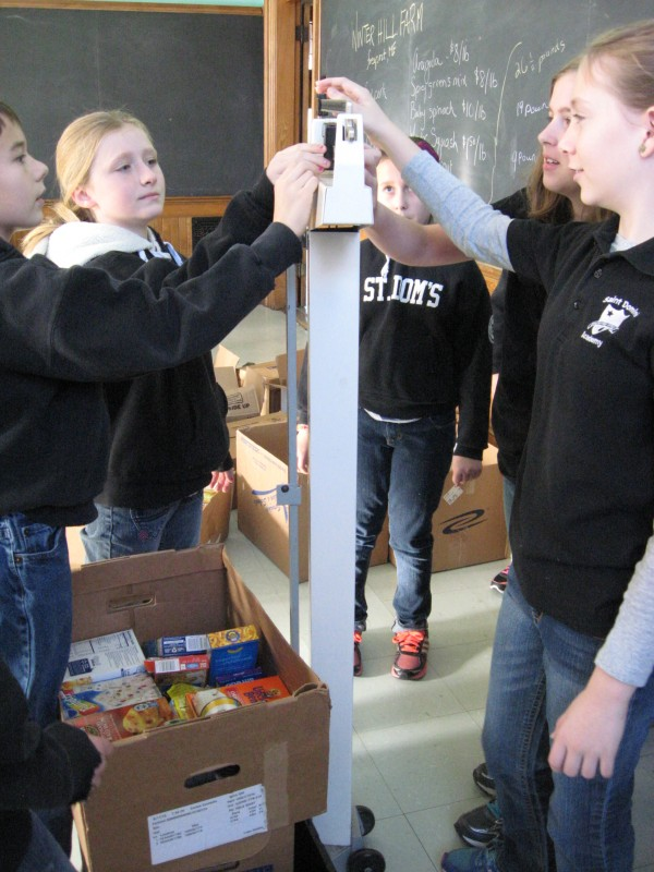 Fifth-graders Matthew Trischler, Sarah Brown, Amelia Fortin, Catherine Dove, and Victoria Cyr weigh food.