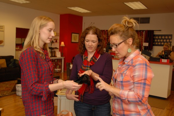 Taking advantage of Plaid Friday sales at Valentine Footwear on Main Street in Bangor, Morgan Cashwell (center) of Linthicum, Md. checks out a Born Sabrina black comfort pump while talking with store employees Emily Hanna (left) and Meg Gipson on Nov. 29.