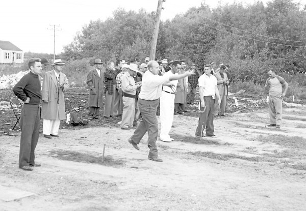 A field of 40 horseshoe pitchers took part in the Maine championships in August 1952 at the Eastco Club courts, South Brewer. It was the largest field ever to participate in a Maine horseshoe tournament. Among the contenders participating (from left) are Thomas Barker, Portland; Roland Boudreault, Lewiston; Merrill Barnes, Bangor, former Maine champion; Thurlow Lord, Hermon; Bob Golightly, Bangor; and Charles Gerrish of Kittery, defending titlist who won the event when he defeated Barnes, 54-38.