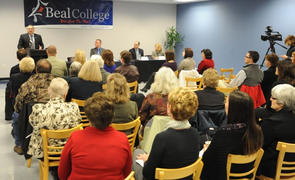 Gov. Paul LePage speaks to a packed room at Beal College about the college's new business concentrations and local entrepreneur initiative on Friday.