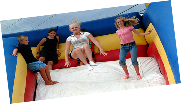 Children play in a bounce house during Hermon's Summer Sizzler event in August of this year.
