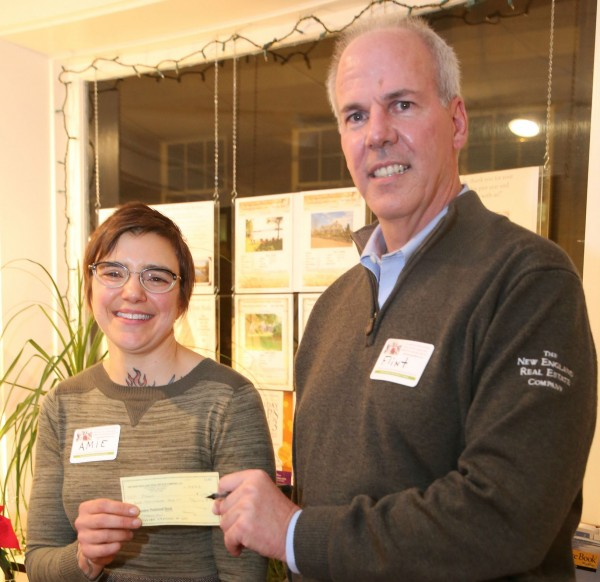 Amie Hutchison, Executive Director for PAWS receiving donation from A. Flint Decker, founder and president of The New England Real Estate Co., on Dec.5.  Marti Stone Photography