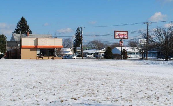 South Portland will explore leasing this land at Westbrook and Main streets to developers who want to replace their existing Dunkin' Donuts shop.
