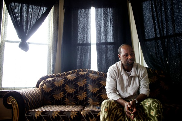 Abdi Maalin, a father of 15 children sits alone in his Lewiston apartment on New Year's Eve. His wife, Salima Nuh, 37, whom he met in a Kenyan refugee camp, was killed Dec. 8 in a head-on collision on Route 196 in Topsham.