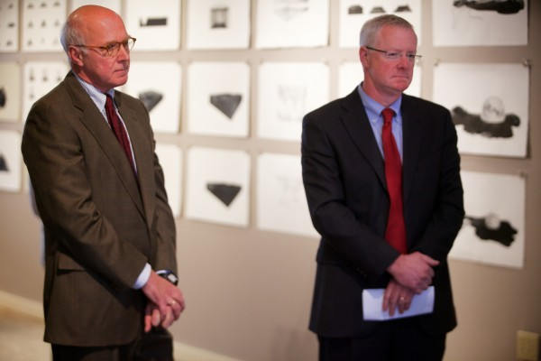 Rev. Tim Boggs (left) and Sen. Richard Woodbury, I-Yarmouth, wait to speak at a press conference in Portland Tuesday where both expressed their disappointment in EqualityMaine's decision to endorse Mike Michaud for governor instead of Eliot Cutler.