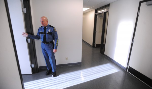 Lt. Wesley D. Hussey leads the tour of the at the new location for the Maine State Police Troop E in Bangor.