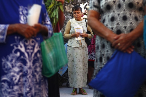 A neighbour of inmate Edgar Tamayo prays outside the Tamayo family house in Miacatlan, Morelos state January 22, 2014.