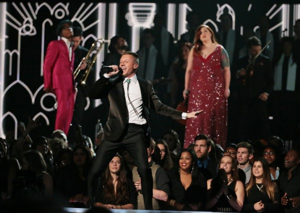 Couples are wedded as Macklemore, pictured, and Ryan Lewis, Mary Lambert, Trombone Shorty and Madonna perform &quotSame Love&quot at the 56th Annual Grammy Awards at Staples Center in Los Angeles on Sunday, Jan. 26, 2014.