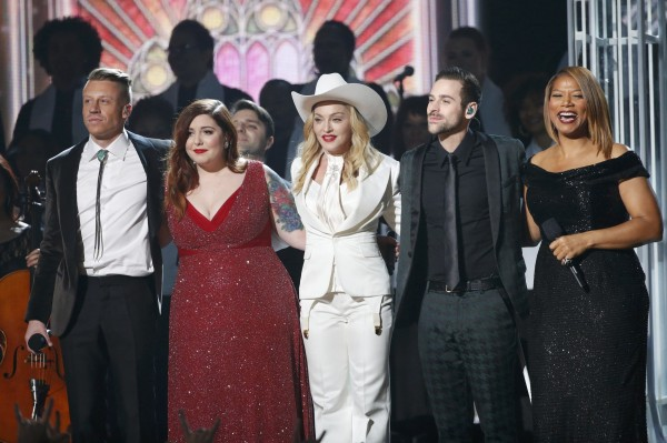 Macklemore, left, Mary Lambert, Madonna, Ryan Lewis and Queen Latifah stand together after performing &quotSame Love&quot at the 56th annual Grammy Awards in Los Angeles, California January 26, 2014.
