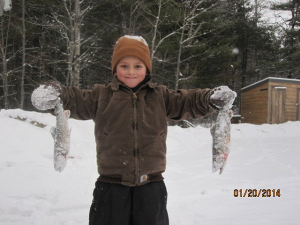 Tristan Martin shows off a couple of fish he and his brothers caught while on an ice fishing trip with his father, Free Martin of Bangor, recently.