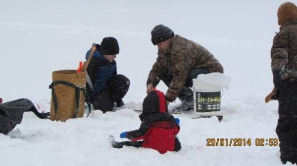 Free Martin of Bangor ice fishes with his sons, Free (from left), Landon and Tristan at Pickerel Pond recently.