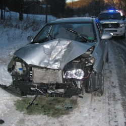 The driver of this demolished 2010 Hyundai Elantra was taken to Rumford Hospital on Friday afternoon when a tire that came off a loaded logging truck on Route 2 near Rumford Center smashed into the car, police said.