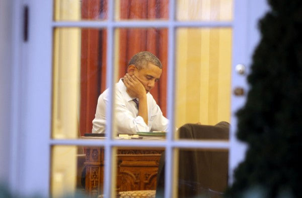 President Barack Obama sits inside the Oval Office as he prepares for the State of the Union Address to the nation while at the White House in Washington, January 27, 2014.