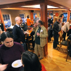 People mingle during a BigGig event at Kosta's Bar and Grill in Old Town Tuesday evening. The event provides a opportunity and encourages entrepreneurs to pitch their business ideas.
