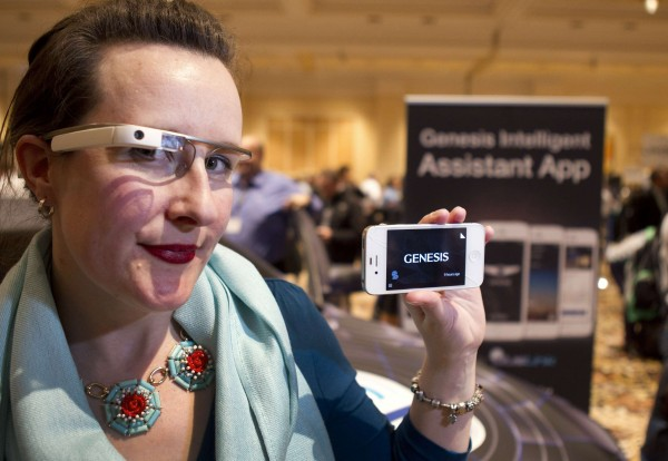 Covisint's Jen Shepherd Moore wears Google Glass, which is integrated with Hyundai Genisis, during Pepcom's &quotDigital Experience&quot, a consumer electronics showcase, in Las Vegas, Nevada, January 6, 2014. Hyundai announced a partnership with Covisint that will allow Genisis owners to access vehicle information through Google Glass.