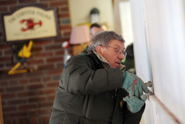 Dick McLaughlin, owner of the Lobster Pound in Lincolnville, works on renovations inside. The restaurant has gone into business with Andrews Brewing Co., also of Lincolnville, and the two will operate as the Lobster Pound Inc. The restaurant/brewery will open in May.