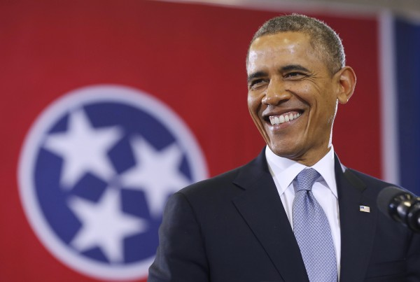 U.S. President Barack Obama smiles before he speaks at McGavock High School in Nashville, January 30, 2014.