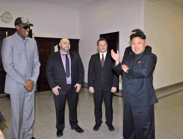 North Korean leader Kim Jong Un talks with Dennis Rodman (L) after they watched a basketball game between former U.S. NBA basketball players and North Korean players of the Hwaebul team of the DPRK at Pyongyang Indoor Stadium in this undated photo released by North Korea's Korean Central News Agency