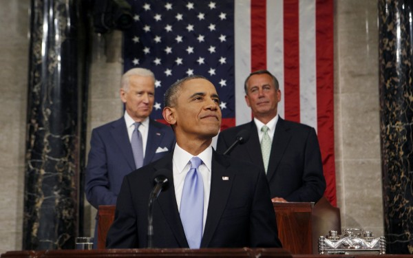 President Barack Obama smiles as he arrives to deliver his State of the Union speech on Capitol Hill in Washington January 28, 2014.