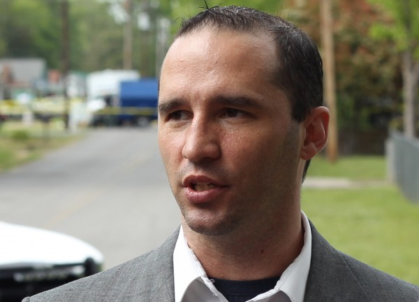 Everett Dutschke speaks to the media as federal officials search his property in Tupelo, Mississippi, April 23, 2013.