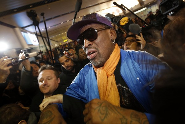 Retired U.S. basketball star Dennis Rodman is surrounded by journalists upon his arrival from North Korea's Pyongyang at Beijing Capital International Airport in this file photo taken January 13, 2014. Rodman has checked into an alcohol rehabilitation center after recently returning from North Korea, according to news reports.