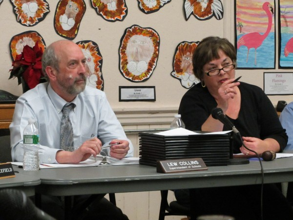 RSU 13 Superintendent Lew Collins and Board Chairwoman Esther &quotTess&quot Kilgour speak before the start of a December 2013 board meeting.