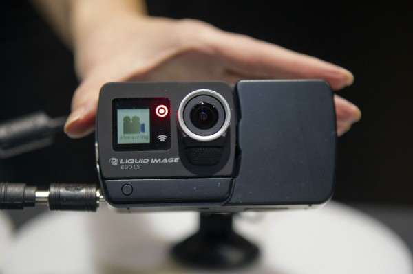 A Liquid Image wearable camera is paired with a 4G LTE module (R) during &quotCES Unveiled,&quot a media preview event to the annual Consumer Electronics Show in Las Vegas, Nevada, Jan. 5, 2014. The camera and module combination make it the first wearable camera that can stream over LTE, a representative said.