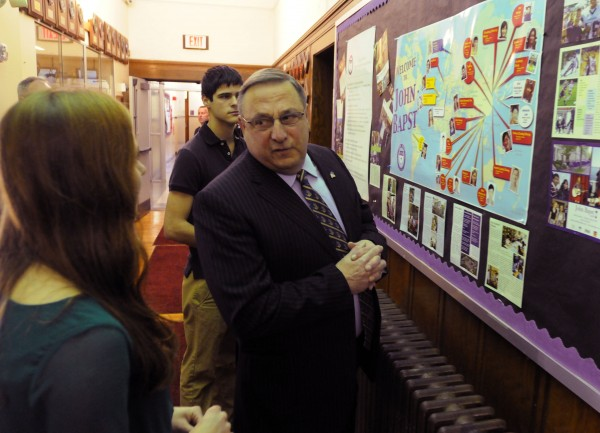 Gov. Paul LePage talks with John Bapst senior Jane Branch during a tour of the school in December before giving a presentation on domestic violence to a packed auditorium. John Bapst senior Noah Potvin (background) also acted as a tour guide.