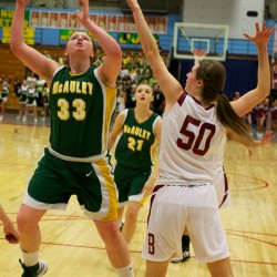 Victoria Lux (left) of Catherine McAuley High School goes to the hoop while guarded by Bangor High School's Cordelia Stewart in March in the Maine Class A Championship game at the Augusta Civic Center.