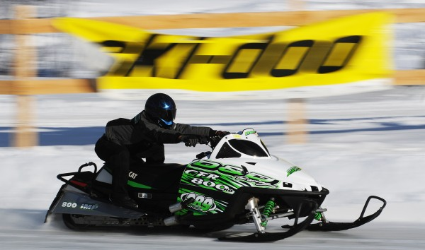 A sledder accelerates down the 2,200-foot ice-covered track at the East Branch Sno Rovers Club in Medway on on Jan. 9, 2011, during the Katahdin Area Snowmobile Racing Affiliates race.