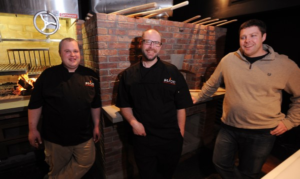 Sous chef Duncan Gunn (from left), executive chef Josh Heikkeinen and owner Matt Haskell share a laugh as they prepare to to open Blaze, Bangor's newest restaurant, on Tuesday.