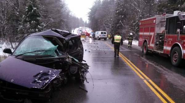 A demolished minivan sits along Route 27 in New Vineyard after a collision that killed the van's driver on Monday.