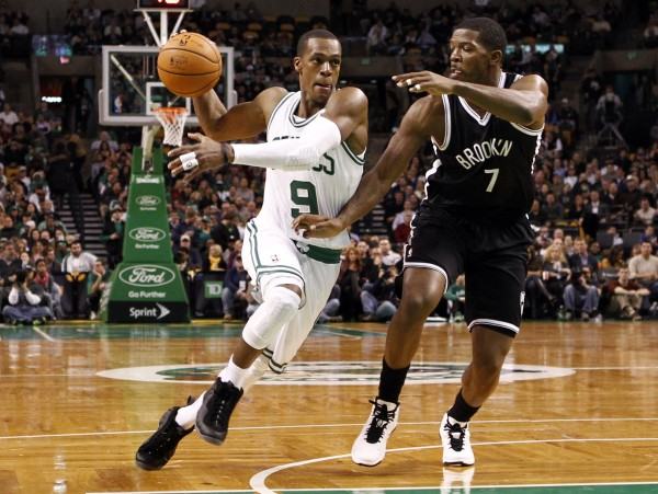 Boston Celtics point guard Rajon Rondo (9) drives to the basket against Brooklyn Nets shooting guard Joe Johnson (7) during the first half at TD Garden Nov. 28.