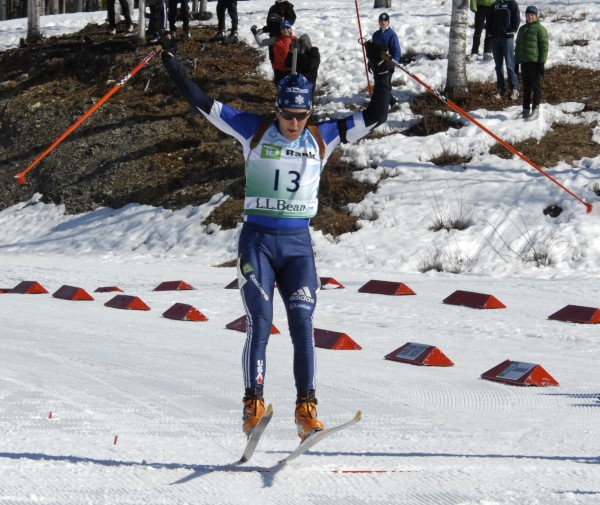 Local fan favorite Russell Currier of Stockholm does a victory jump crossing the finish line first in the men's mass start race at the U.S./North American Biathlon Championships in Fort Kent in March 2010.