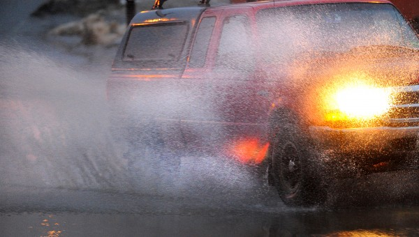 A pickup truck drives through a puddle on Harlow street in Bangor Saturday.  The freezing rain and melting snow created hazardous driving conditions throughout the state.
