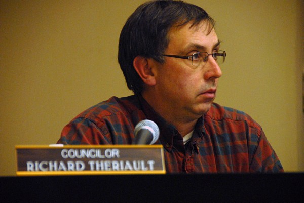New Millinocket Town Council member Richard Theriault listens during a council meeting on Thursday, Jan. 9, 2014.