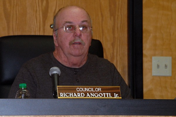 New Millinocket Town Council Chairman Richard Angotti Jr. listens during a council meeting on Thursday, Jan. 9, 2014.