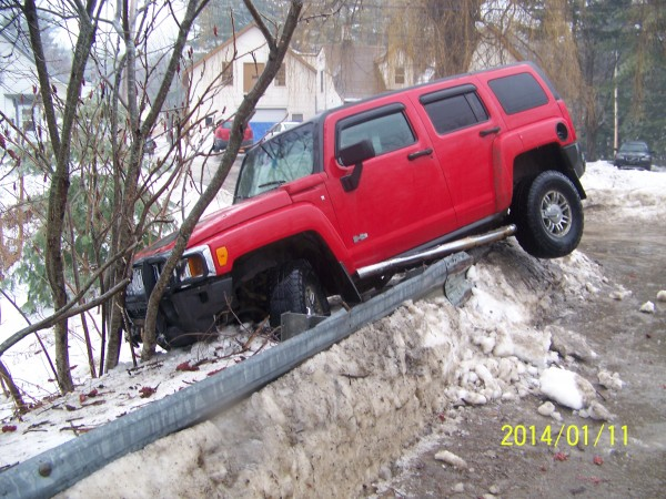 Freezing rain made for treacherous driving conditions across Maine on Saturday morning. This Humvee went off the road on Union Street in Orono.