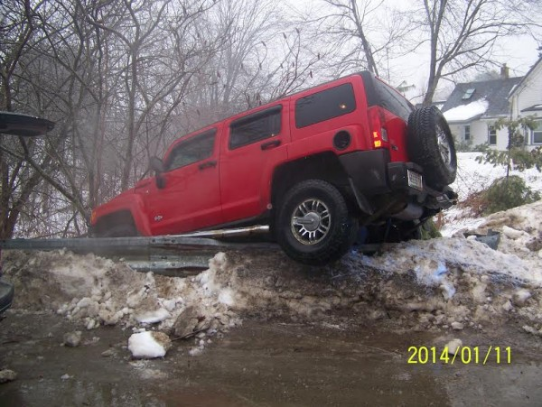 A Humvee went off the road in Orono Saturday morning, just one of many accidents across the state after heavy freezing rain blanketed roads.