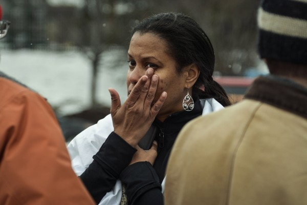 Tarah William of Lanham, Md., reacts after she was evacuated from a building after  a shooting at a shopping mall in Columbia, Md., Saturday. Three people died in the shooting outside of Baltimore and one of the dead was believed to be the shooter, police said.