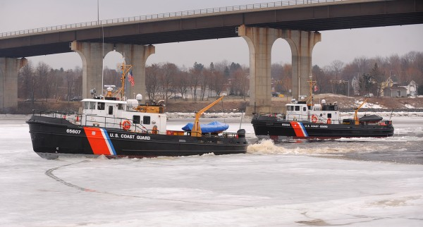 U.S. Coast Guard cutters Bridle (left) and Tackle break ice on the Penobscot River in Bangor on Saturday.