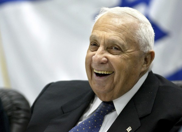 Israel's Prime Minister Ariel Sharon smiles during a meeting with army and police forces at an army base near Jerusalem in this Jan. 5, 2005, file photo.  Sharon passed away Saturday at the age of 85.
