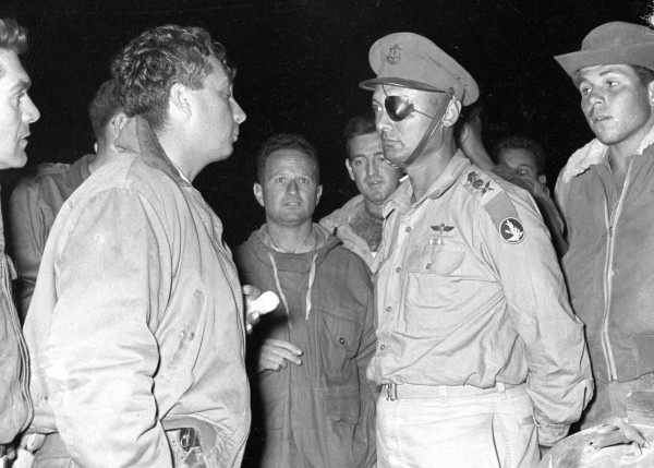 Ariel Sharon (left) stands with Moshe Dayan during a military operation in this handout file picture taken Sept. 11, 1956, and released by Israel's Defense Ministry. Ariel Sharon, the former Israeli general and prime minister who was in a coma for eight years after he had a stroke at the height of his power, died on Saturday at 85, Israeli Army Radio said, quoting a relative of his family.