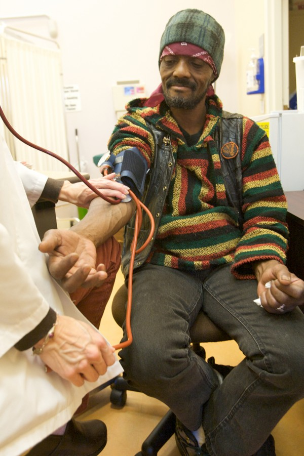 Mark McForbes gets is blood pressure and blood sugars checked Thursday, Dec. 22, 2011, at the Health Care for the Homeless Clinic on Portland Street in Portland.