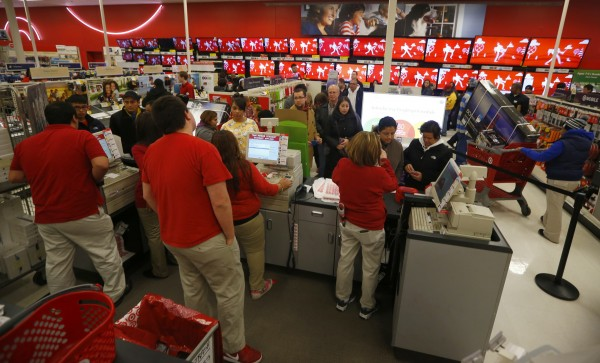 Thanksgiving Day holiday shoppers wait at the checkout lines at the Target retail store in Chicago, Illinois, in this November 28, 2013 file photo.