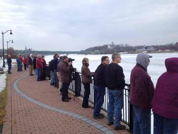 A crowd gathers at the Bangor Waterfront to watch two U.S. Coast Guard ice cutters break through ice on the Penobscot River on Saturday.
