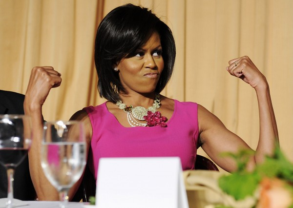 First lady Michelle Obama flexes her arms during the White House Correspondents' Association Dinner in Washington in this photo taken May 9, 2009. Michelle Obama turned 50 on Friday and in an interview with People magazine, she said that she aspires to remain fit and active into her 70s and 80s.