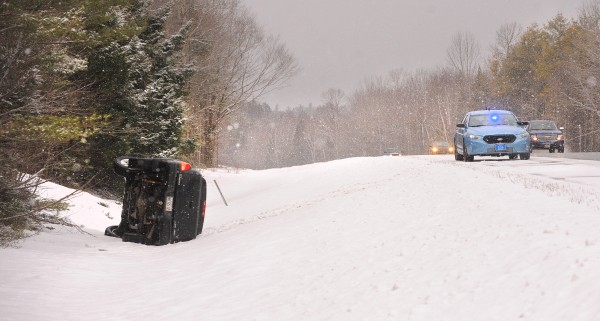 This pickup truck slid off the road and rolled over in the northbound lane of I-95 in Carmel on Saturday.
